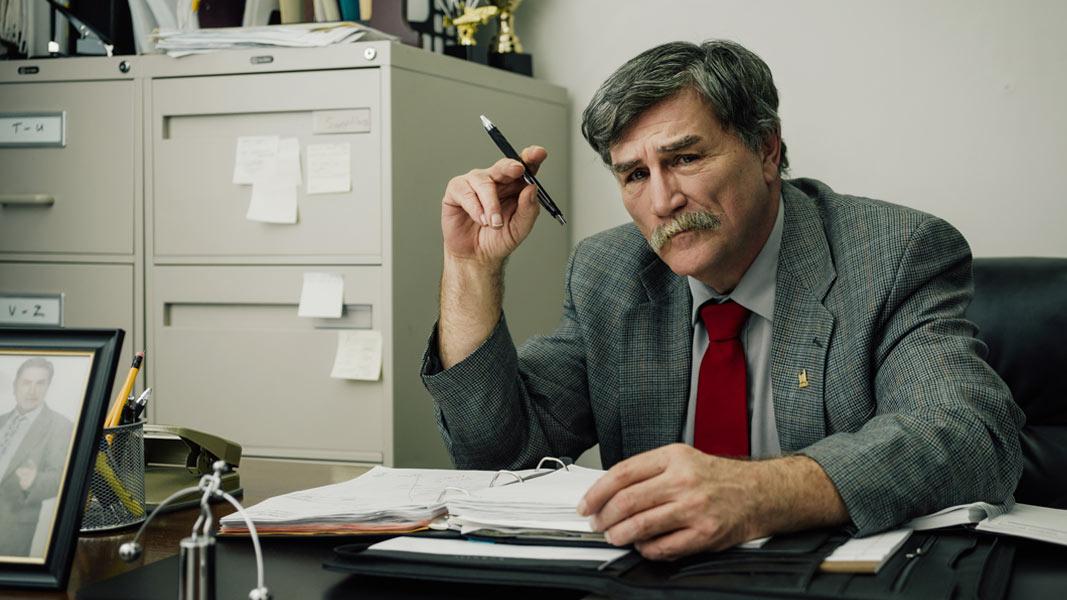 Bob Cuts at his desk