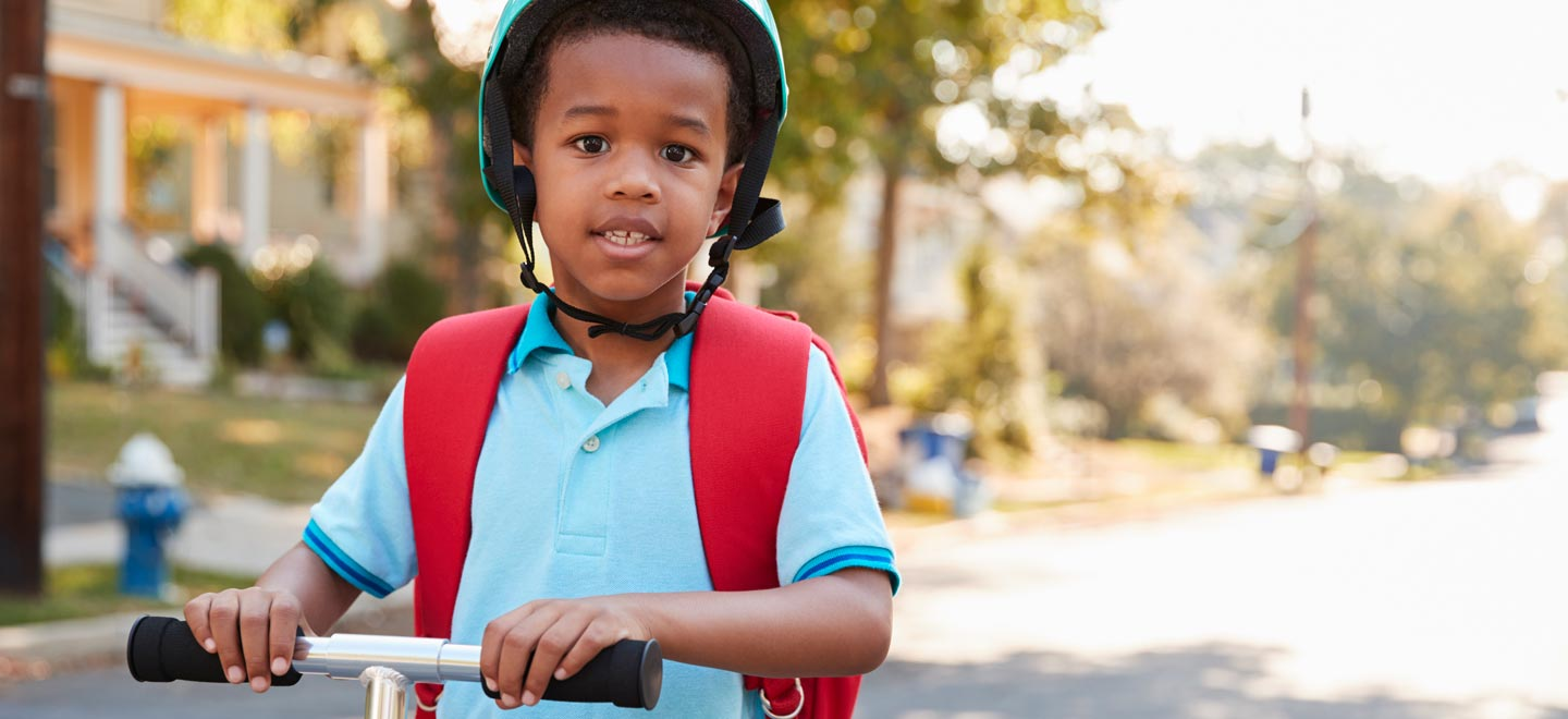 Kid on scooter